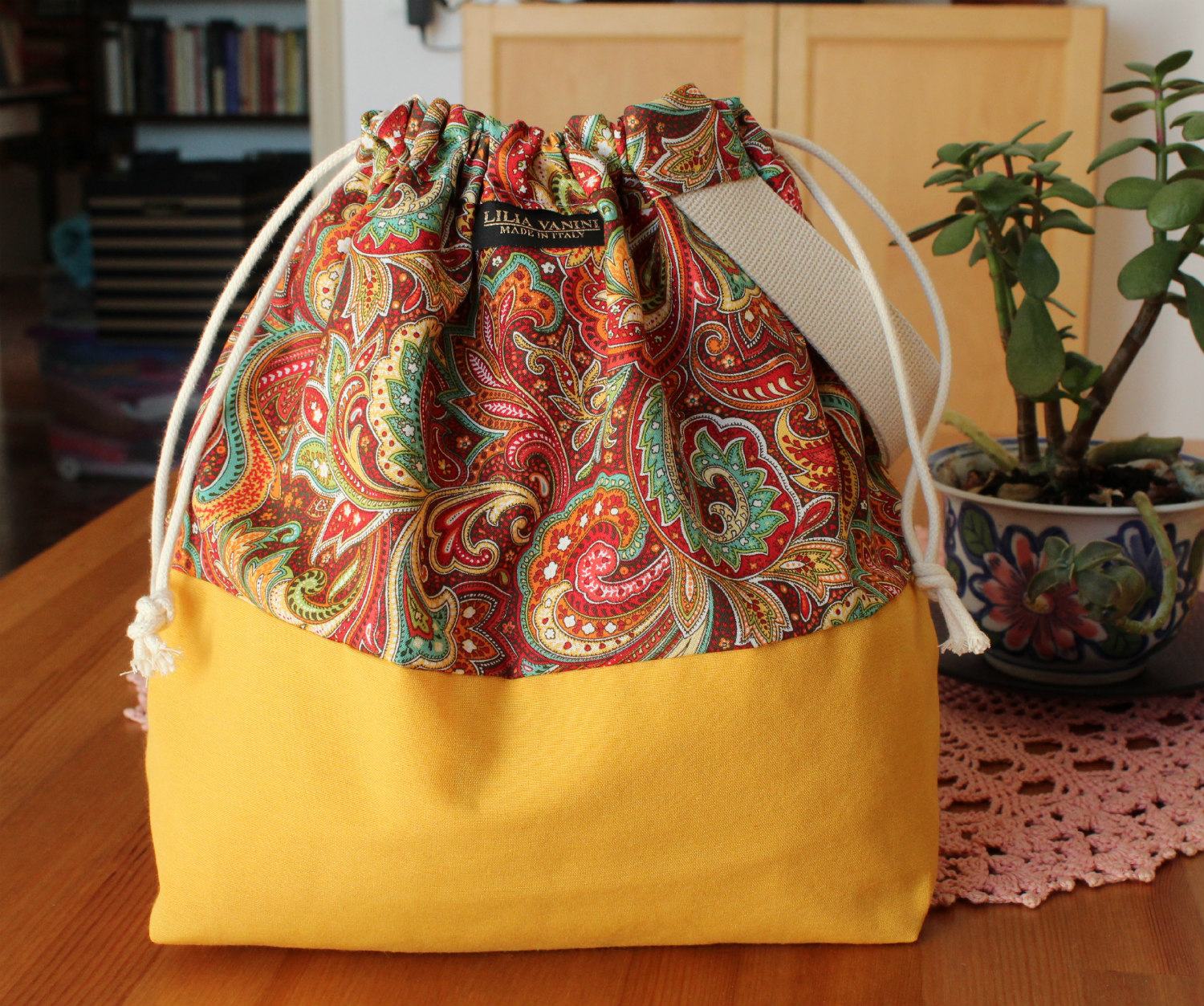 drawstring Knitting Project Bag yellow and floral paisley design with wristlet handle handmade by Lilia Vanini Liliacraftparty