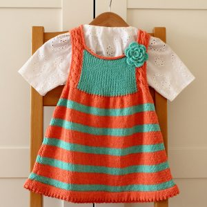 Emily Baby Dress stripes baby dress with crochet flower baby knitting pattern by Lilia Vanini / Liliacraftparty