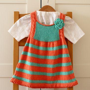 Emily Baby Dress stripes baby dress with crochet flower baby knitting pattern by Lilia Vanini / Liliacraftparty