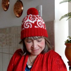 red white curly hat knitting pattern pop art hat woman wearing pop art knitting hat with pom pom